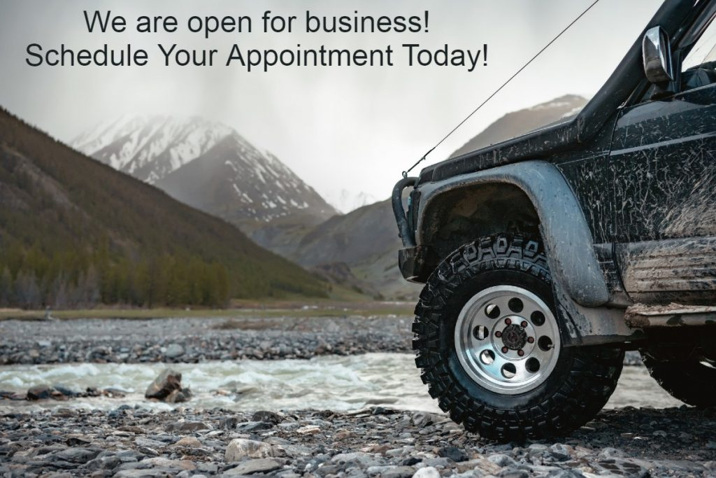 Transmission Repair & Auto Repair Shop in Colorado Springs, CO Jeep in the Mountains by a stream